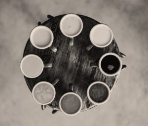 Coffee mugs with different shades of coffee inside